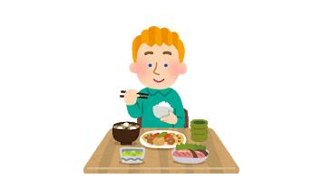 和食を食べる外国人